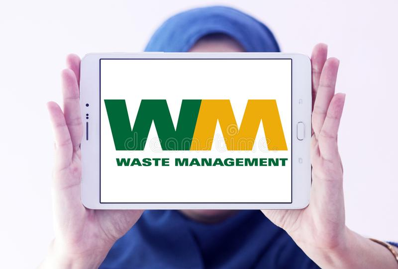 Waste Management company logo. Logo of Waste Management company on samsung tablet holded by arab muslim woman. Waste Management, Inc. is an American waste royalty free stock image