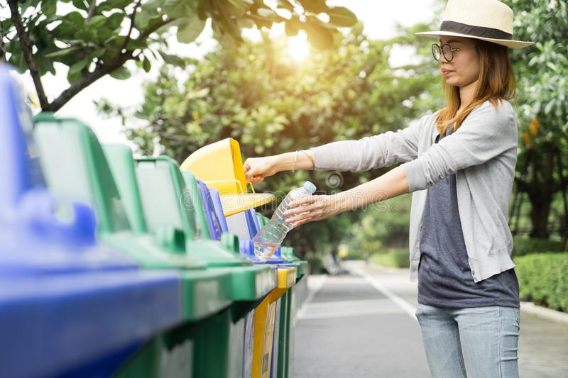 Waste management, Woman throwing plastic bottle into recycle bin. Waste separation rubbish before drop to garbage bin to save the. World, environment care royalty free stock photography