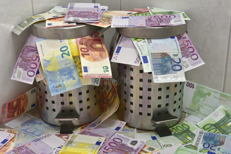 Waste of Money. Two waste paper baskets filled with Euro banknotes stock photography