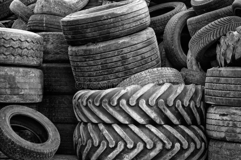 Waste of old used car tires ready to be recycled. stock photos