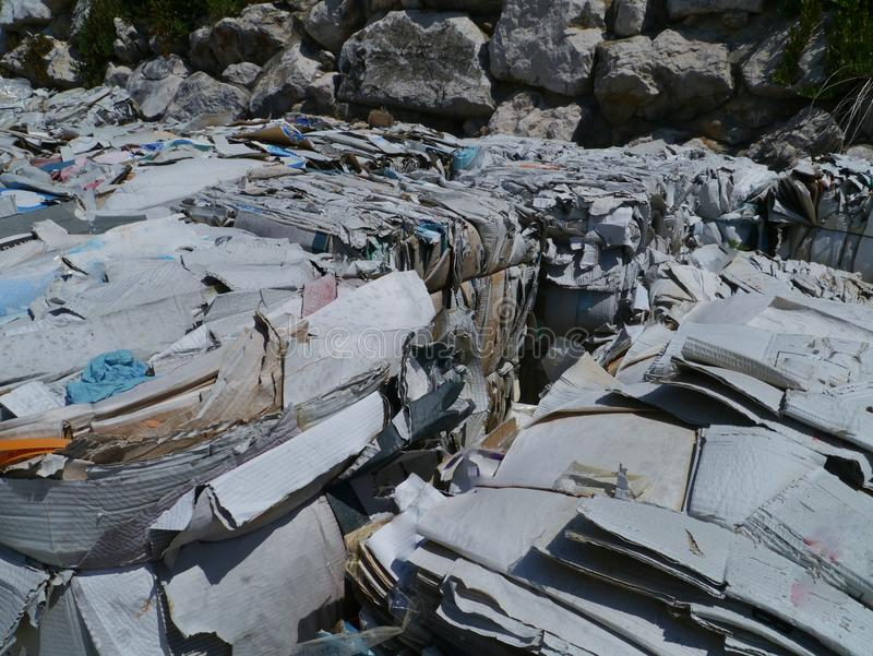 Waste paper and cardboard bales stock images