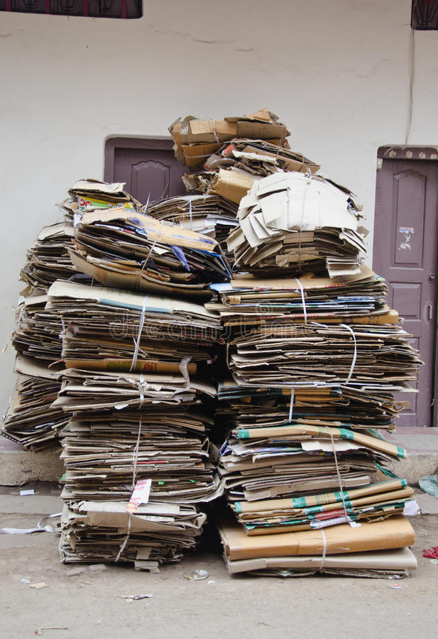 Waste paper cardboard for recycling in street. Waste paper cardboard for recycling in India city street stock images
