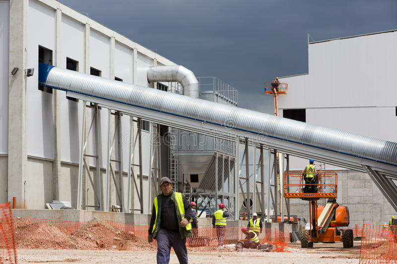 Waste plant outside process workers stock images