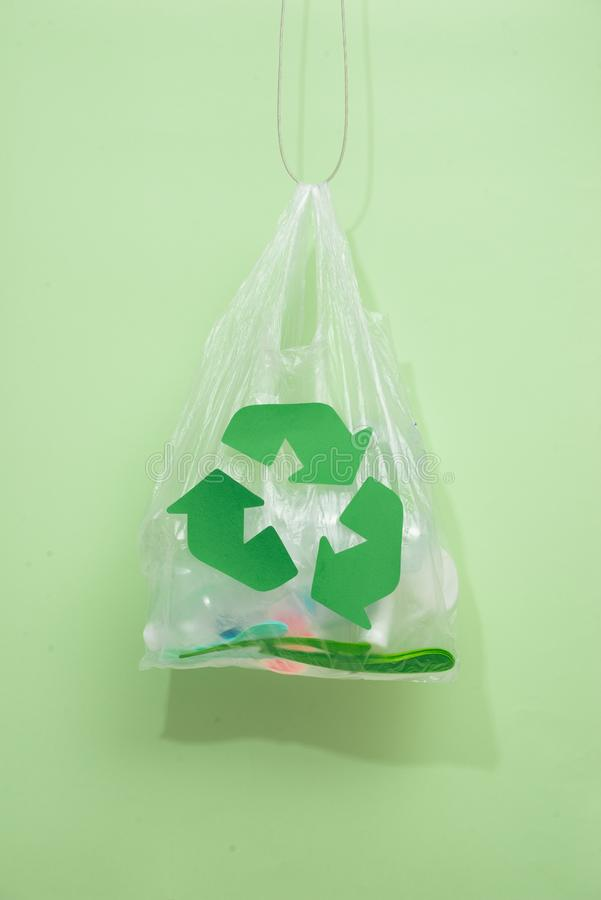 waste recycling, reuse, garbage disposal, environment and ecology concept - close up of rubbish bag with trash or garbage and stock photos
