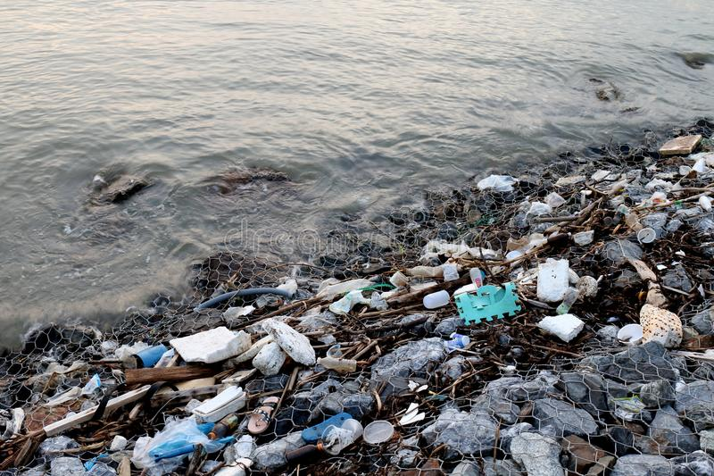 Waste seaside, Garbage on beach Pollution, Waste trash in river, Toxic waste, Wastewater, Dirty water in river stock image