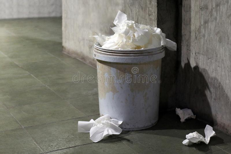 Waste toilet paper, Garbage bin, Trash toilet paper dirty full of trash can bin old in a toilet. The Waste toilet paper, Garbage bin, Trash toilet paper dirty royalty free stock photos