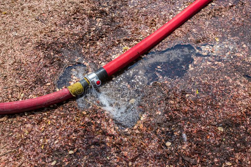 Waste water from pipe leaking. leaking fire pipeline joints. A ruptured hose. plumbing broken joints pipe in the hole with water royalty free stock image