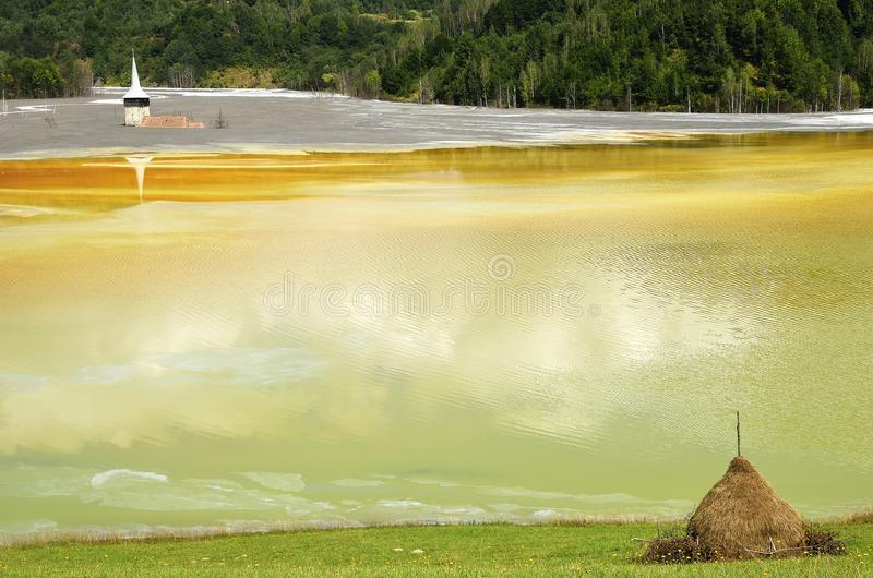 The Waste water pollution of a copper mine. Geamana, Rosia Montana, Romania. Waste water pollution of a copper mine. Geamana, Rosia Montana, Romania stock photography
