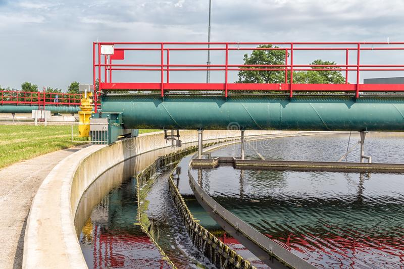 Waste water in secondary sedimentation tank of sewage treatment plant. This is the last step of the cleaning process with removing the last smaller particles stock image