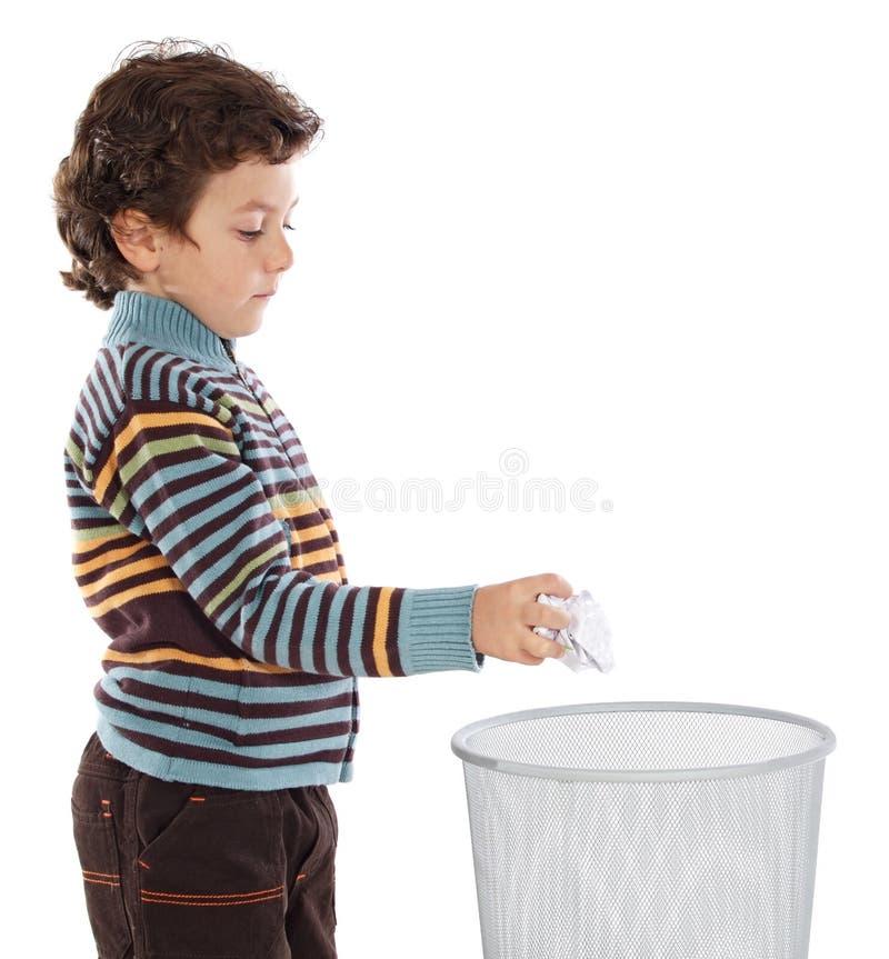 wastebasket мальчика стоковая фотография