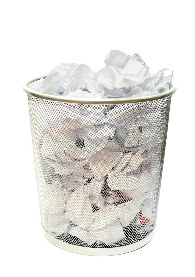 Wastebasket. Metal wire wastebasket full of trash on a white background royalty free stock image