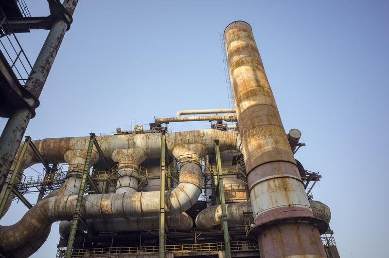 Wasted steel factory with ruin funnel. Wasted steel factory in beijing city with ruin blast furnace machine stock photo