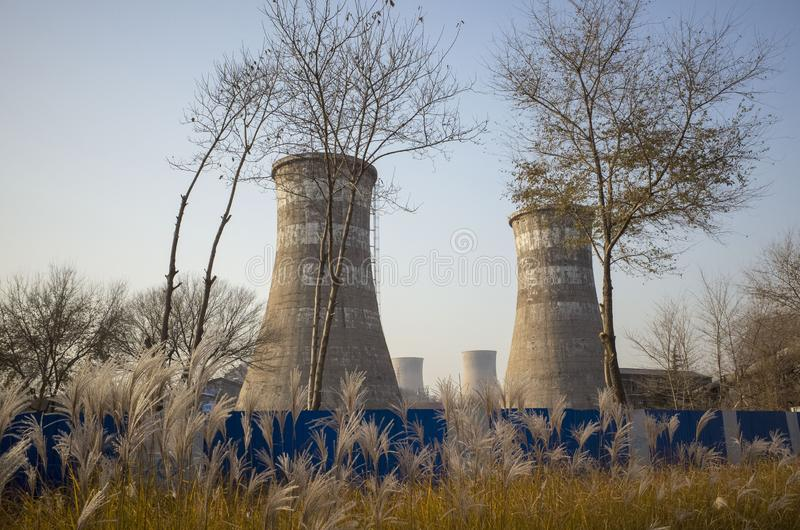 Wasted steel factory with ruin funnel. Wasted steel factory in beijing city with ruin blast furnace machine stock image