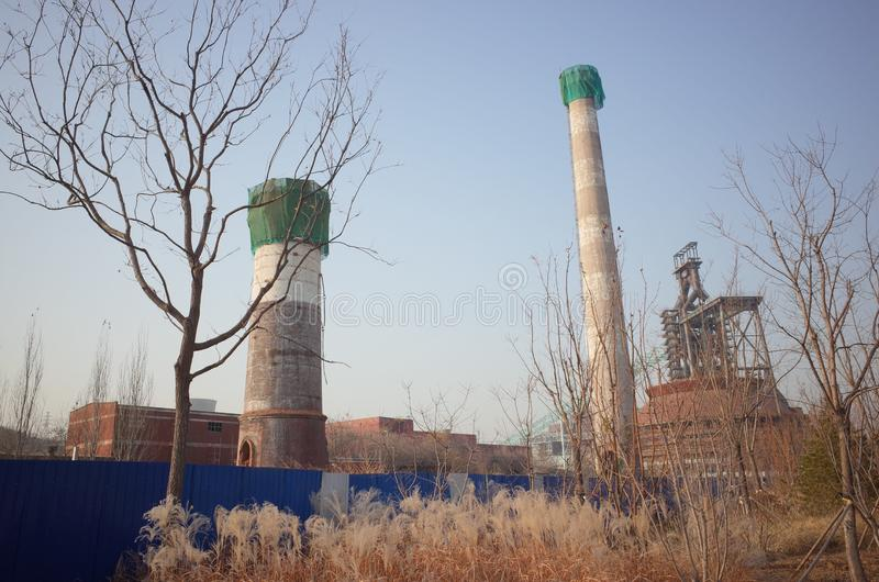 Wasted steel factory with ruin machine. Wasted steel factory in beijing city with ruin blast furnace machine royalty free stock image