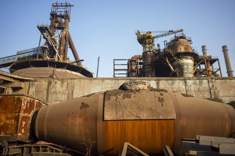 Wasted steel factory with ruin machine. Wasted steel factory in beijing city with ruin blast furnace machine royalty free stock photo