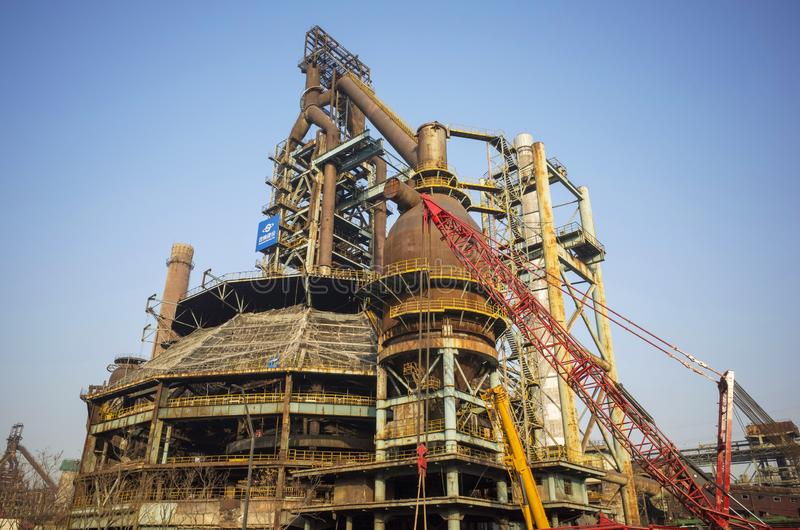 Wasted steel factory with ruin machine. Wasted steel factory in beijing city with ruin blast furnace machine royalty free stock images