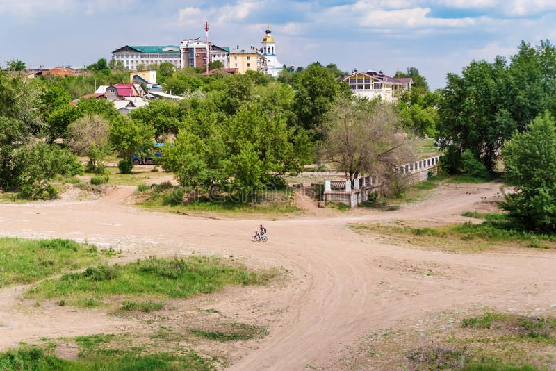 Wasteland on the outskirts of the city. Orenburg, Russia - June, 1, 2019: Summer cityscape. Wasteland on the outskirts of the city royalty free stock photos