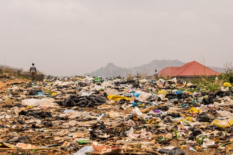 Wasteland of toxic rubbish dumps. A dump of toxic wastes dumps of old rubber bags and other objects causing environmental hazard in Abuja, Nigeria, Africa royalty free stock images