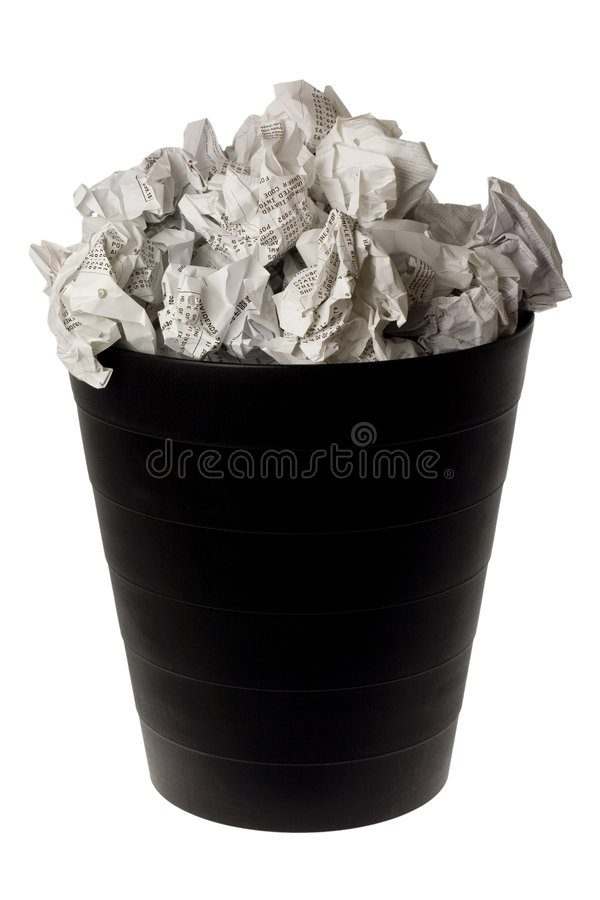 Wastepaper basket full of crumpled paper. Isolated on white background royalty free stock photos