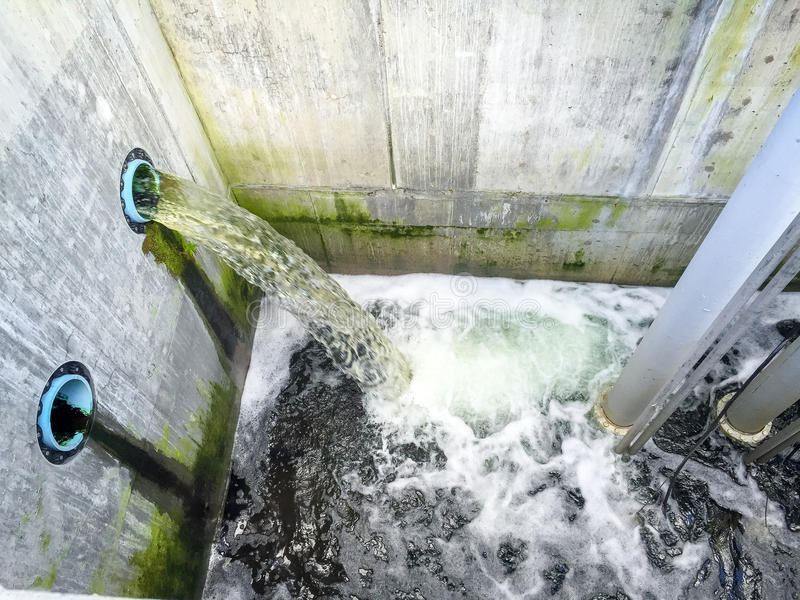 Wastewater Pouring into Primary Clarification Tank at Sewage Tre. Atment Plant stock photo