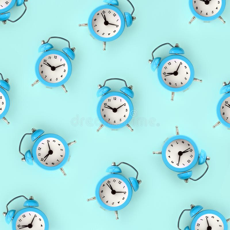 Wasting time concept. Many blue alarm clock stock illustration