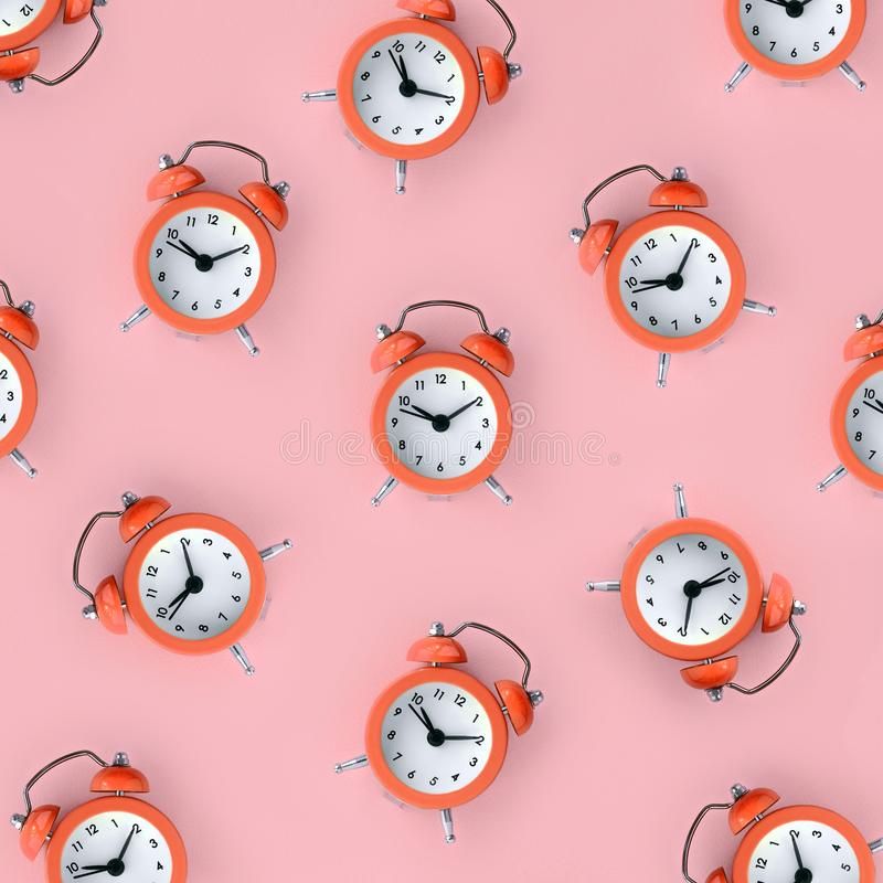 Wasting time concept. Many coral red alarm clock. Flat lay retro beautiful new alarm clock on coral red color background. Minimal pattern. Top view. Wasting time stock photos