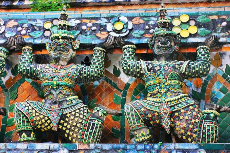Wat Arun buddhist temple in Bangkok, Thailand - details royalty free stock photos