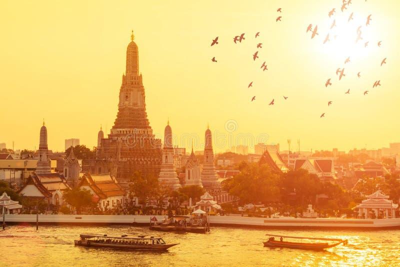 Wat arun with flying birds in sunset at Bangkok,Thailand. Wat arun with flying birds in sunset at Bangkok,Thailand stock image