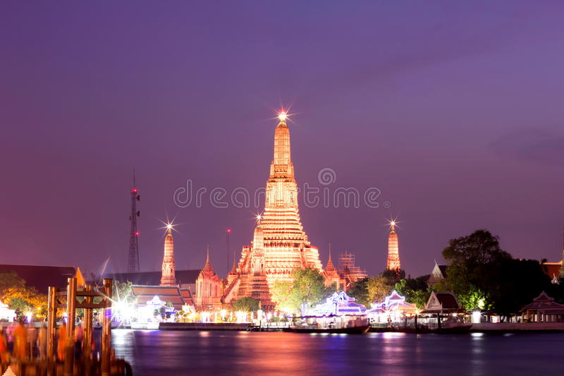 Wat Arun during Sunset at Bangkok, Thailand. View of Wat Arun temple during sunset from Chao Phraya River at Bangkok, Thailand royalty free stock image