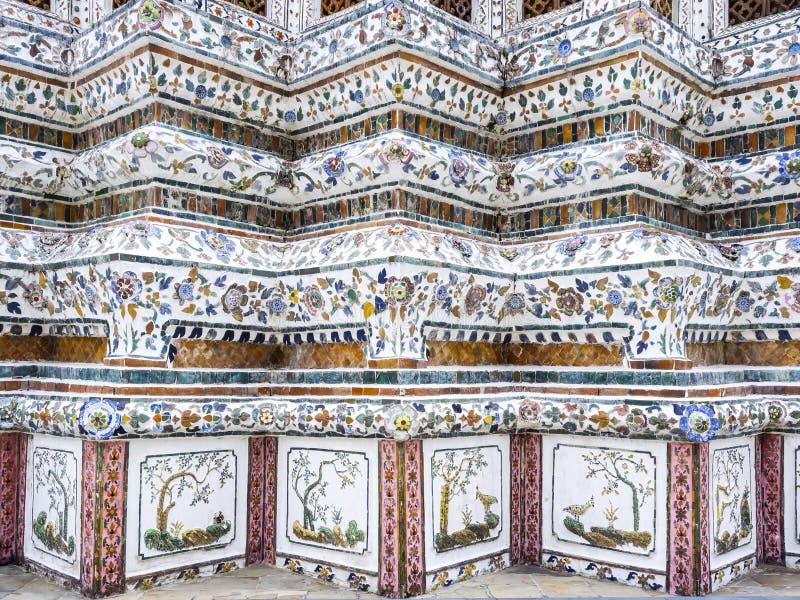 Wat Arun temple Colourful tiles floral pattern Mosaic on Pagoda Landmark Architecture Bangkok Thailand. Wat Arun temple Colourful tiles floral pattern Mosaic on royalty free stock images