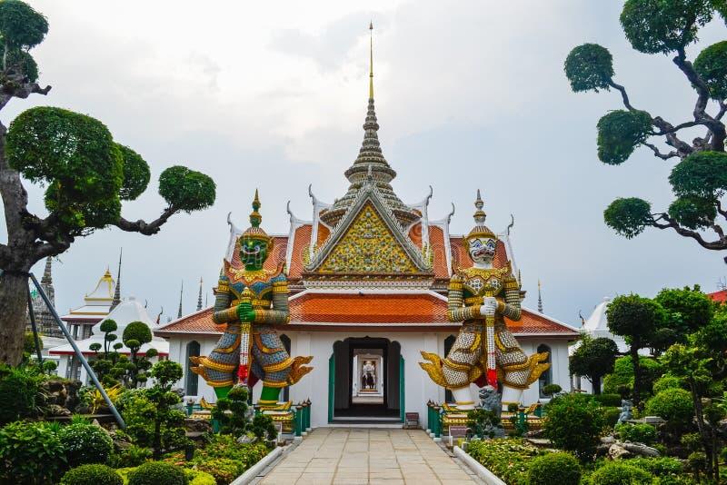Wat Arun, Wat Arunrajawararam, Bangkok. Thai temple, gates with the gigantic guardians protecting it, Thailand, river temple stock photos