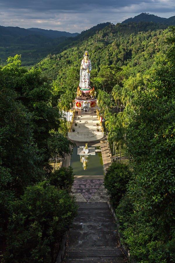 The statue of goddess Guan Yin in Wat Bang Riang in Thailand. Wat Bang Riang in Thailand, Asia. The statue of goddess Guan Yin in jungles stock image