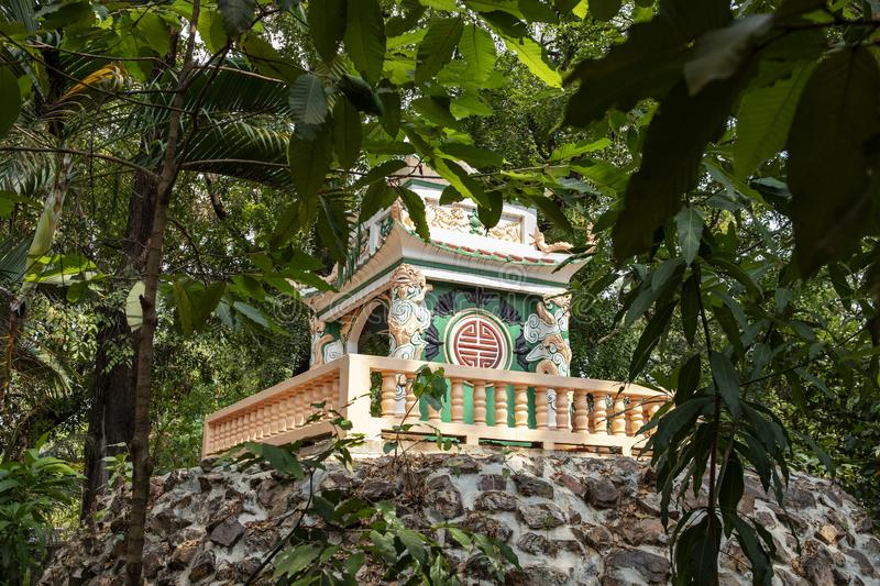 Wat Damnak pagoda in Siem Reap, Cambodia. Traditional buddhist pagoda architecture in green trees. Cambodian religious building. Siem Reap place of interest royalty free stock image