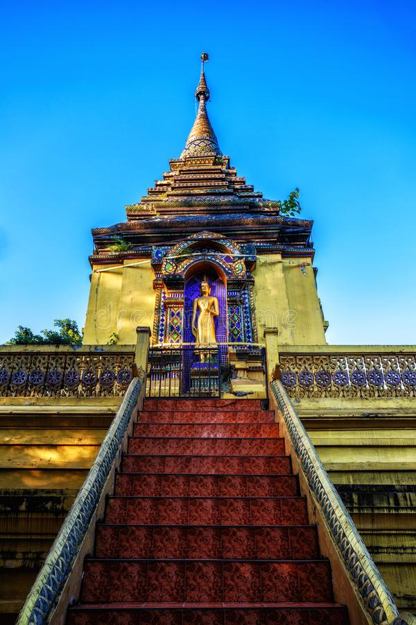 Wat Doi Phrabat is a monastery at chiangrai Thailand. The stairway directly to Buddha statue on pagoda royalty free stock photos