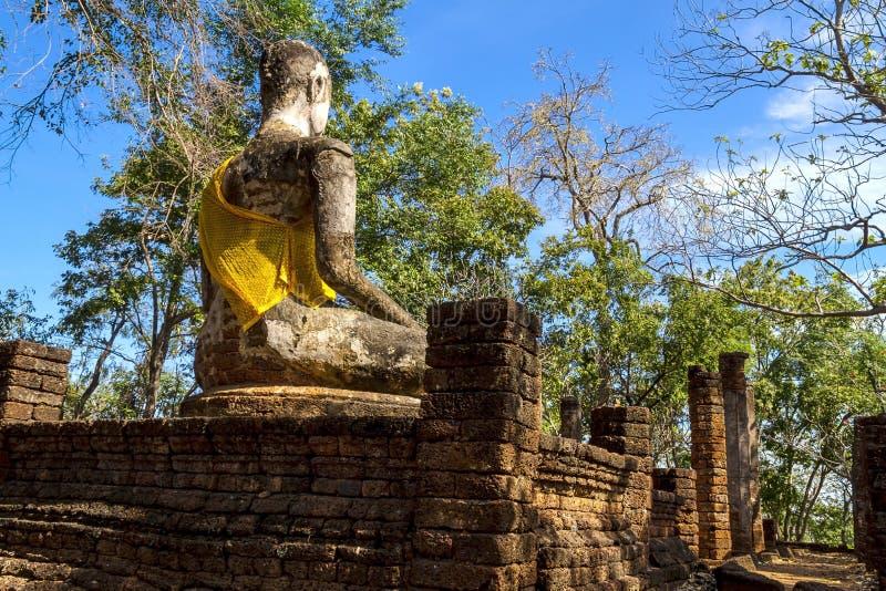 Wat Khao Phanom Phloeng stature and blue sky. Wat Khao Phanom Phloeng stature buddha and blue sky in Sisatchanalai Historical Park, Sukhothai province Thailand royalty free stock images