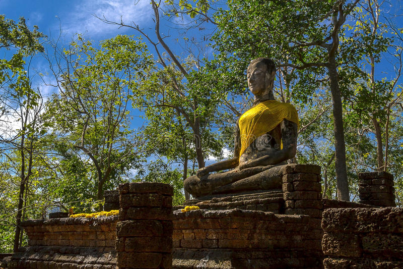 Wat Khao Phanom Phloeng stature buddha with clear sky. Wat Khao Phanom Phloeng and stature buddha with clear sky in Sisatchanalai Historical Park, Sukhothai royalty free stock photos