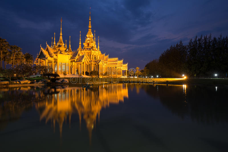 Wat Luang Pho Toh temple with water reflection in night time, Th. Wat Luang Pho Toh temple with water reflection in night time at Nakhon Ratchasima province stock image