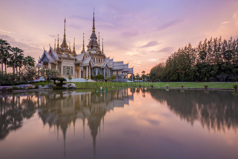 Wat Luang Pho Toh temple with water reflection in twilight time, Thailand. Wat Luang Pho Toh temple with water reflection in twilight time at Nakhon Ratchasima royalty free stock image