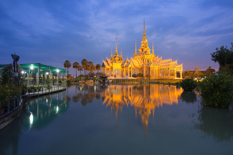 Wat Luang Pho Toh temple with water reflection in twilight time, Thailand. Wat Luang Pho Toh temple with water reflection in twilight time at Nakhon Ratchasima stock photo