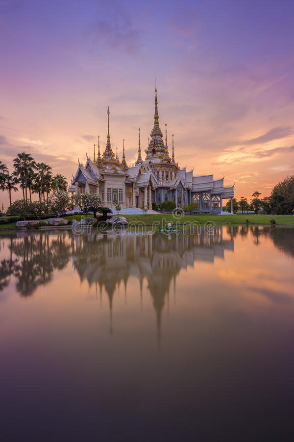 Wat Luang Pho Toh temple with water reflection in twilight time, Thailand stock images