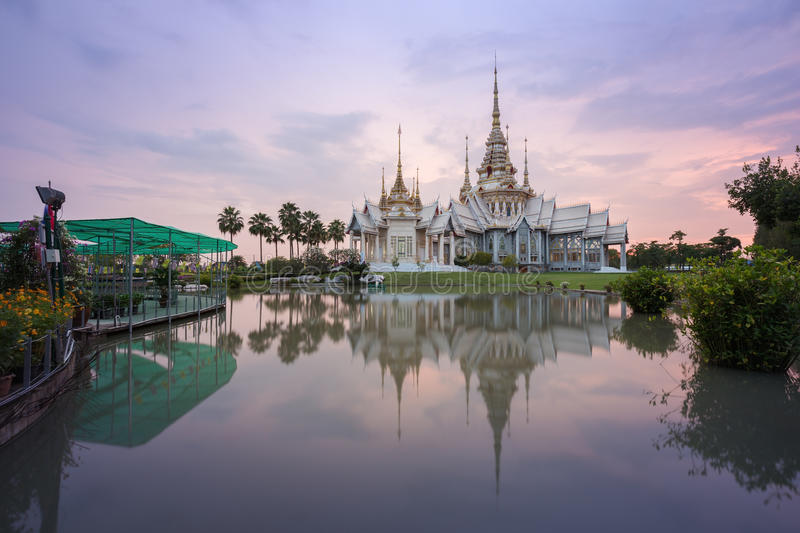 Wat Luang Pho Toh temple with water reflection in twilight time, Thailand. Wat Luang Pho Toh temple with water reflection in twilight time at Nakhon Ratchasima royalty free stock photography
