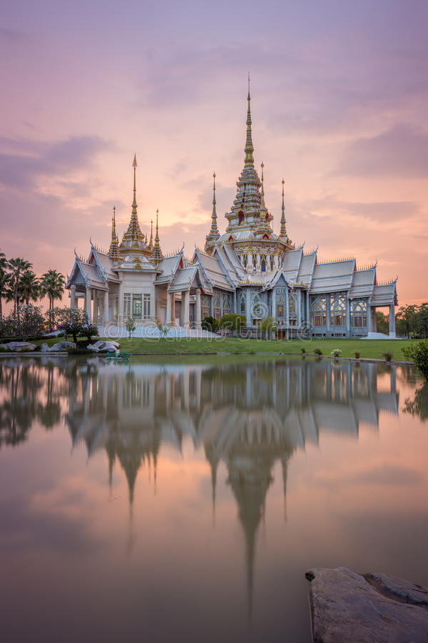 Wat Luang Pho Toh temple with water reflection in twilight time, Thailand. Wat Luang Pho Toh temple with water reflection in twilight time at Nakhon Ratchasima royalty free stock photo