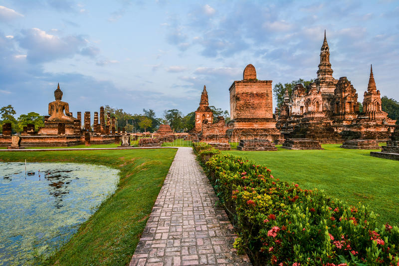 Wat Mahathat, the old city of Sukhothai, Thailanda. Sitting Budha in Wat Mahathat, historical park which covers the ruins of the old city of Sukhothai, Thailanda stock image