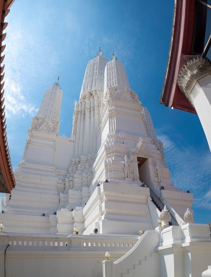 Wat Mahathat Woravihara. Temple Petchburi blue sky background royalty free stock photo