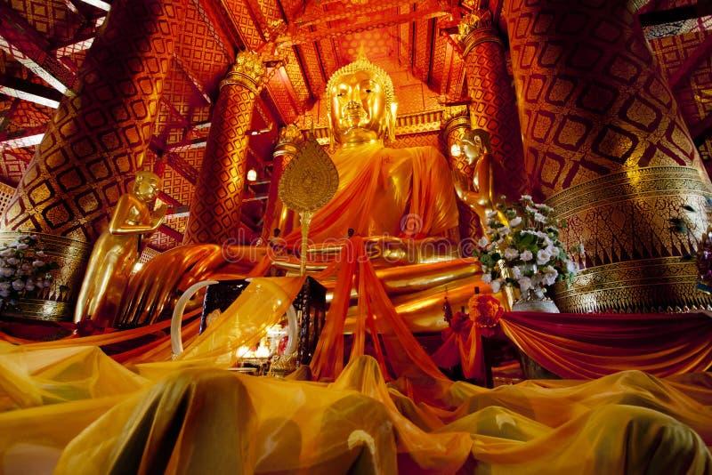 Wat Phanan Choeng temple ,Ayutthaya, Thailand. People touch cloth of Buddha image in Wat Phanan Choeng temple stock photos