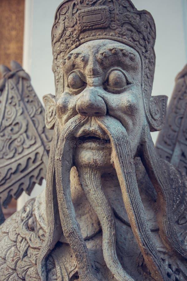 Wat Pho石头监护人雕象 曼谷泰国 免版税库存图片