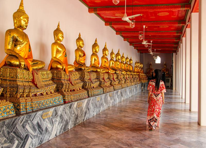 Buddhist statues in buddhist temple in Bangkok royalty free stock photo