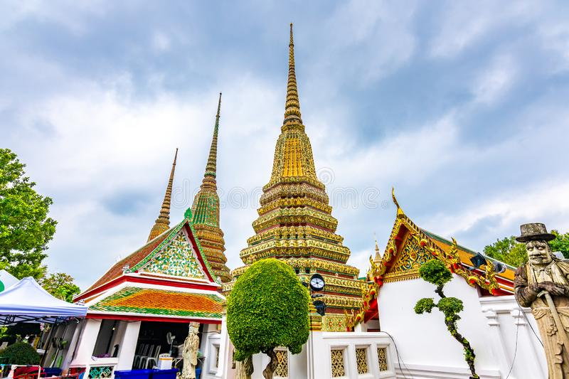 Wat Pho temple in Bangkok city, Thailand. View of pagoda and stupa in famous ancient temple. Religious buildings in buddhism style. Near Grand Palace. Oriental stock photo