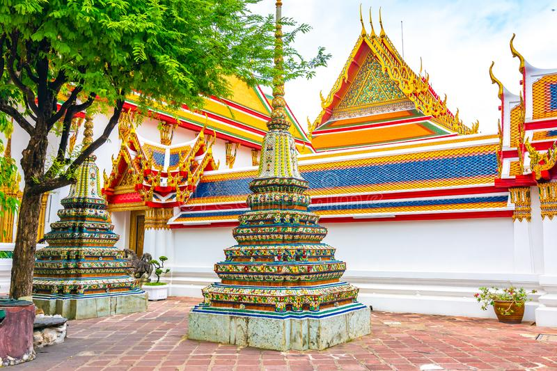 Wat Pho temple in Bangkok city, Thailand. View of pagoda and stupa in famous ancient temple. Religious buildings in buddhism style. Near Grand Palace. Oriental royalty free stock images