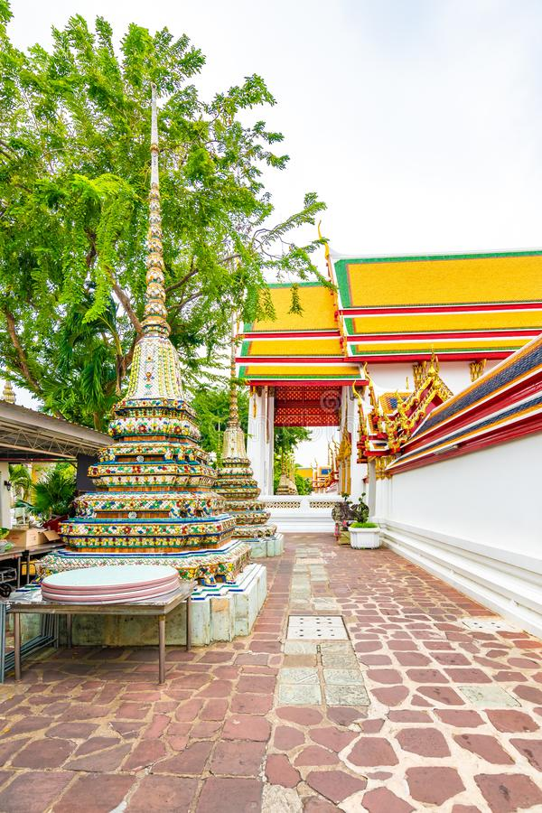 Wat Pho temple in Bangkok city, Thailand. View of pagoda and stupa in famous ancient temple. Religious buildings in buddhism style. Near Grand Palace. Oriental royalty free stock photos